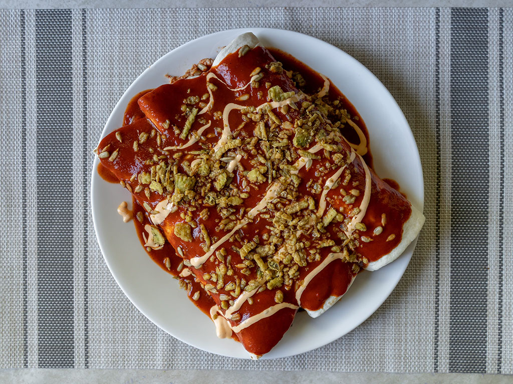 Enchiladas with rosarita sauce and fresh gourmet crisp jalapenos