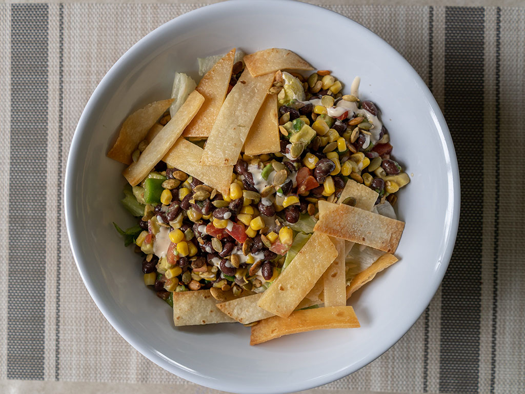 Black bean and corn salad with tortilla strips