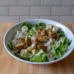Caesar salad with nuggets