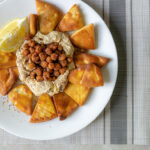 Pita chips with hummus and chickpeas
